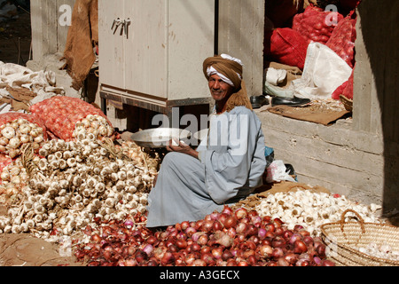 An old Man trades vegetables at the Souk Market in Luxor, Egypt - Stock Photo