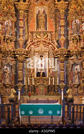 Main altar of San Xavier del Bac Mission Tohono O odham Indian Reservation near Tucson Arizona - Stock Photo