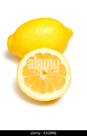 Lemon whole and halved isolated on a white studio background. - Stock Photo