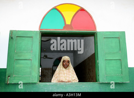 Muslim lady looking out of a window , Araromi Mosque , Porto Novo , Benin - Stock Photo
