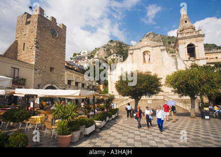 April 9th Square Piazza and  Church of Saint St Augustine with tourists in sun sunshine and pavement cafes Taormina - Stock Photo