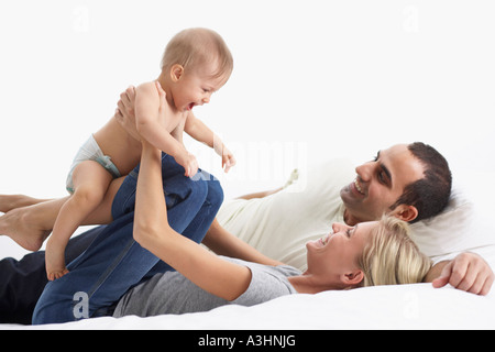 Mother and Father Playing with Baby - Stock Photo
