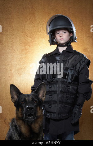 Girl Dressed as Policewoman with Police Dog - Stock Photo