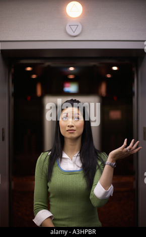 Woman in Front of Elevator - Stock Photo