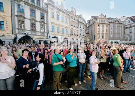 CZECH REPUBLIC PRAGUE OLD TOWN HALL TOURISTS WATCHING THE ASTRONOMICAL CLOCK - Stock Photo