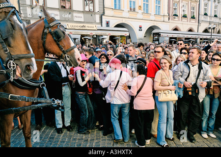 CZECH REPUBLIC PRAGUE OLD TOWN HALL OLD TOWN SQUARE TOURISTS WATCHING THE ASTRONOMICAL CLOCK - Stock Photo