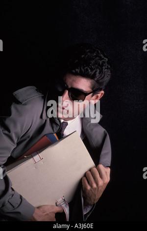 Spy running away - Stock Photo