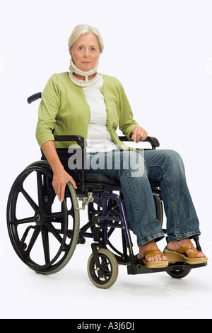 Woman sat in a wheelchair - Stock Photo