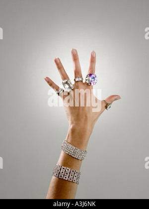 Woman wearing rings and bracelets - Stock Photo