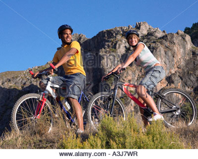 Two teenagers riding bicycles - Stock Photo