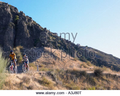 Two teenagers cycling - Stock Photo