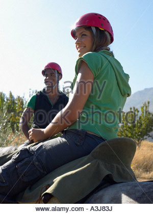 Two teenagers riding horses - Stock Photo