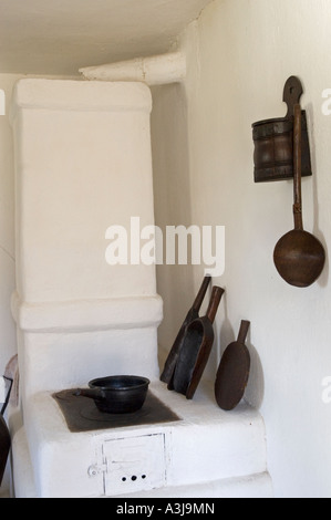 Kitchen of peasant house at Village Museum. (Muzeul National al Satului Dimitrie Gusti) in Bucharest Romania - Stock Photo