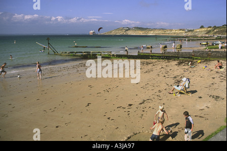 Holidaymakers on beach at Colwell Bay Isle of Wight England UK - Stock Photo