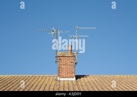 Aerials on a chimney - Stock Photo