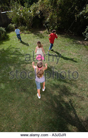 Children playing blind mans bluff - Stock Photo