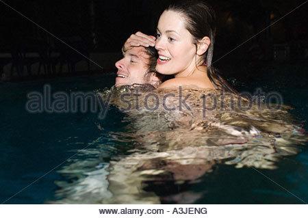 Couple in swimming pool - Stock Photo