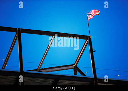 American flag on construction framework - Stock Photo