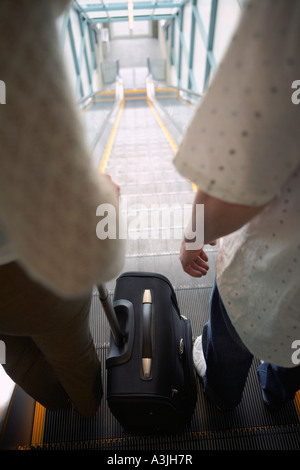 People on Escalator - Stock Photo