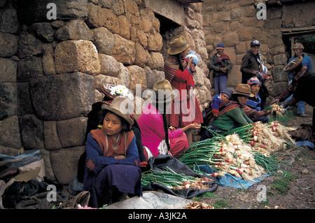 market inside historic inka stone wall masonry village of chinchero near city of cuzco peru - Stock Photo