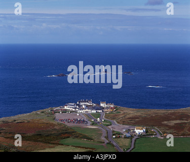 Lands End with Longships Lighthouse offshore Cornwall UK aerial view - Stock Photo