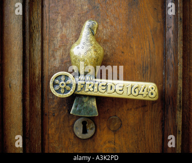 door handle at the door of the city hall of Osnabrueck, inscription 'Peace 1648' remembering the Westphalian Peace - Stock Photo