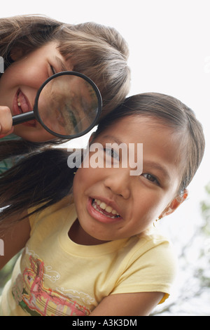 Portrait of Girls With Magnifying Glass