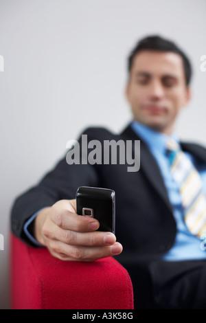 Man's Hand Holding Cellular Telephone - Stock Photo
