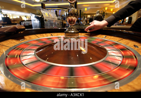 A croupier spins the roulette wheel at the Rendezvous Casino in Brighton - Stock Photo