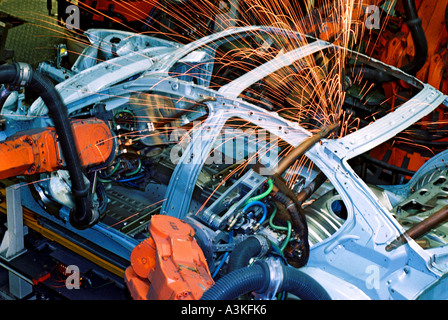 Industry robot robotics spot welding car production at BMW in Munich Bavaria Germany - Stock Photo