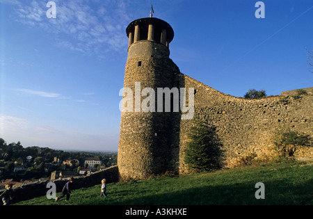 Children playing next to fortress ramparts in the village of Cremieu, Isere, France. - Stock Photo