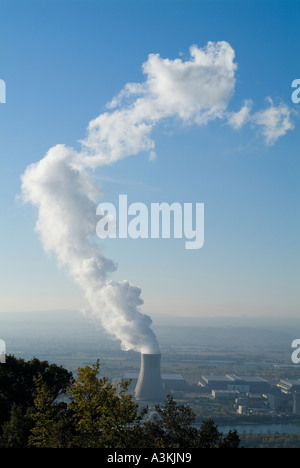 Smoke emitting from cooling towers Tricastin nuclear power plant in the Rhone river valley Drome France - Stock Photo