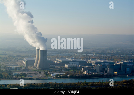 Smoke emitting from cooling towers Tricastin nuclear power plant in the Rhone river valley, Drome, France - Stock Photo
