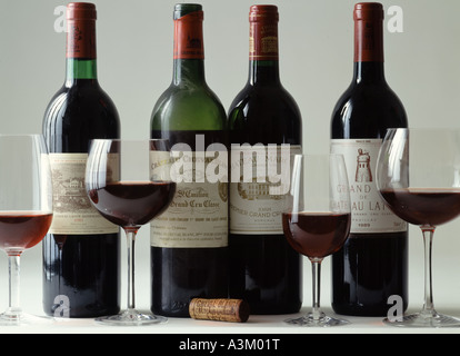Bottles of Bordeaux Grand Cru Classé vintage red wines and glasses - Stock Photo