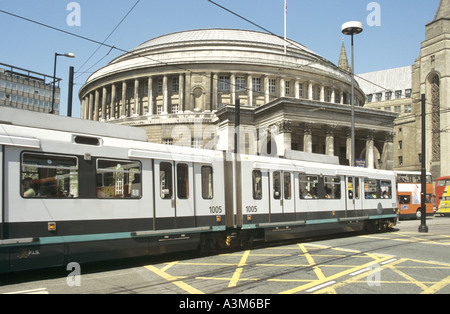 Manchester tram crossing box junction circular central library beyond - Stock Photo