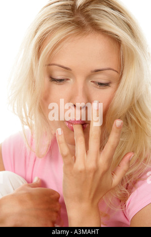 Woman licking her finger - Stock Photo