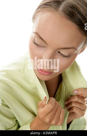 Young woman wearing green coat - Stock Photo