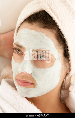Portrait of mature woman with face mask - Stock Photo
