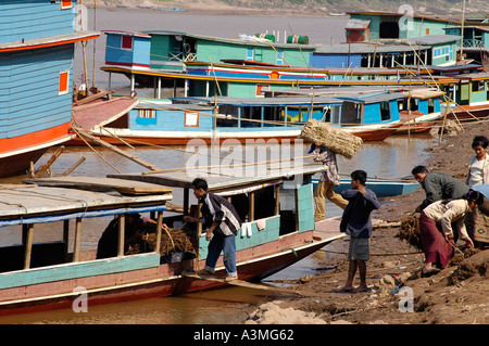 Loading Ships in Port of Louangphrabang on Mekong River Laos Southeast Asia - Stock Photo