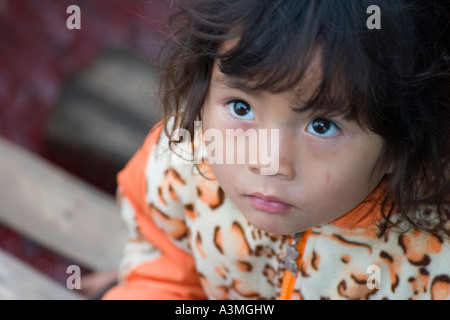 Young girl on a vendor boat on the Halong Bay - Stock Photo