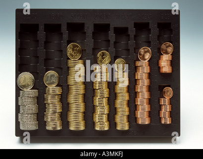 THE 8 DIFFERENT EURO AND CENT COINS STACKED IN CASH TRAY - Stock Photo