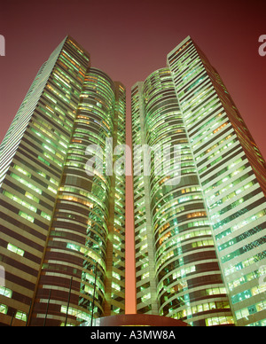 Towers of Exchange Square seen at dusk Hong Kong - Stock Photo
