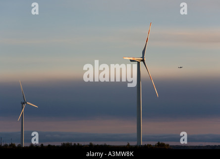 Large wind turbines at sunset against colourful evening sky , Finland - Stock Photo