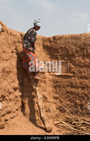 Village woman, Larabanga, Ghana, using ridgid ladder made