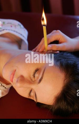 Hopi Ear Candling - Stock Photo