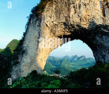 Famous moon hill limestone arch near Yangshou, Guangxi ...