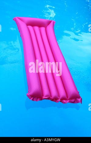 inflatable air mattress red blue aqua stock photo