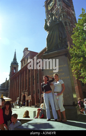 Two young women posing in front of the statue of Nicolaus Copernicus in Torun, Poland - Stock Photo
