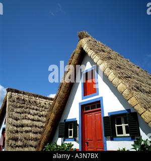 TWO  PALHEIROS  TRADITIONAL THATCHED HOUSES  SANTANA  VILLAGE  MADEIRA  ISLAND PORTUGAL - Stock Photo