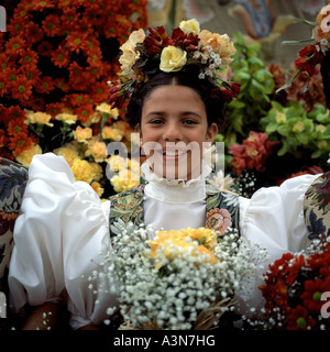 GIRL'S PORTRAIT WITH TRADITIONAL COSTUME AND FLOWER HEADDRESS AT SPRING FLOWER FESTIVAL  FUNCHAL  MADEIRA  ISLAND - Stock Photo
